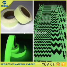Photoluminescent vinyl film for safety sign systems