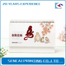 Китайский поставщик бесплатный образец золото обработкой паром. партнер настенный календарь