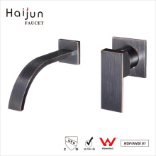 Haijun 2017 barato artístico sola manija generalizada de lavabo de pared latón grifos