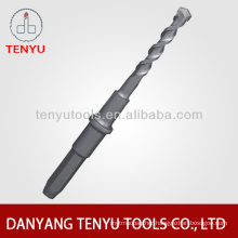 Four squares shank hammer drill bit in Standard Flutes drilling concrete and stone