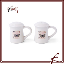 stone ware spice and petter shakers with decal pattern