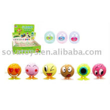 wind up jump smiling face toy