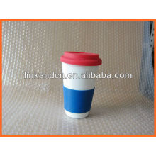 Haonai KC-00937 ceramic mug with silicone lid and sleeve