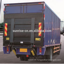 Vehicle tail lift axle for trailers