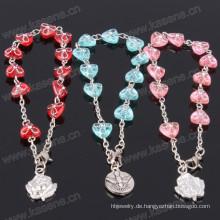 Großhandel viele Farbe runden Kunststoff Rosenkranz Armband mit Saint Anhänger
