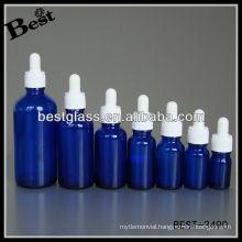blue essential oil bottle with white plastic cap, white rubber, glass dropper; dropper bottle with white plastic cap