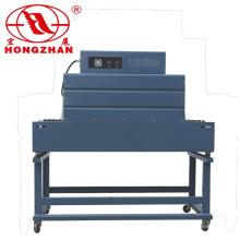 Pequena máquina de embalagem encolhendo com forno de fogão para enrolamento automático rápido envolvimento embalagens para aparelhos eléctricos de prancha
