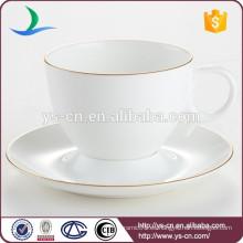 Taza de café de porcelana de hotel de lujo y platillo con encaje de oro de alta calidad