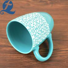 Promotional price travel souvenir ceramic relief mug