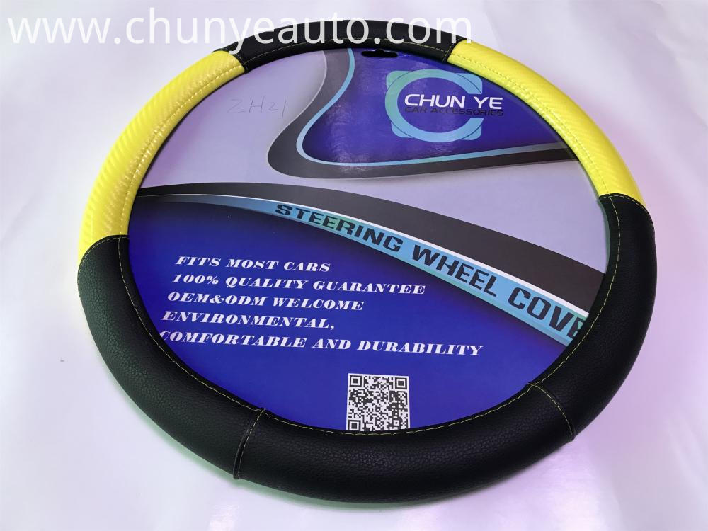 yellow and black leather steering wheel cover