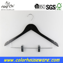 Black wooden hanger with clips