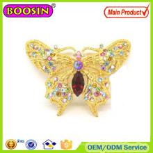 Broche de oro con broche de mariposa de cristal personalizado con precio de fábrica