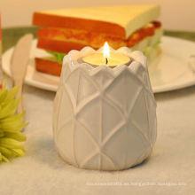 Candelero de cerámica blanco de la luz del té