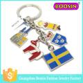 Großhandelsförderungsgeschenk preiswerte Art- und Weisegewohnheit Metallflagge Keychain
