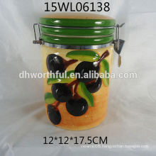 Ceramic storage jar with olive design for kitchen