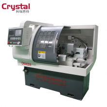 O eixo grande fura e manda o centro de giro da máquina do torno do CNC CK6432A