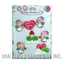 Los ángeles dulces bordaron el paquete de la etiqueta engomada
