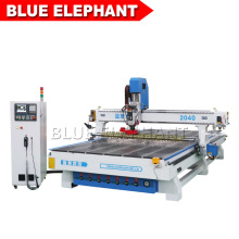 2040 3D Woodworking CNC Router Atc CNC Router with Carousel Tool Changer and Press Roller