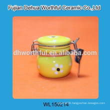 Lovely ceramic seal pot with yellow flower figurine