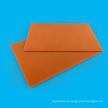 Hoja laminada de papel fenólico negro / naranja eléctrico