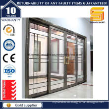Puerta interior con vidrio y diseños decorativos de la parrilla del hierro labrado