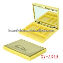 Caja compacta vacía del esmalte de ojos amarillo con el espejo