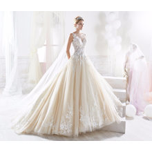 Robe de mariée en dentelle champagne perles
