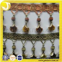 Manufatura artesanal de pompom trim, franja para cortina