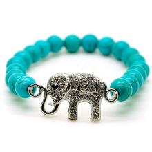 Venta al por mayor de turquesa de 8 mm granos redondos estirar pulsera de piedras preciosas con accesorio de elefante de diamante