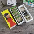 caixa de empacotamento dos bolinhos coloridos bonitos do produto comestível
