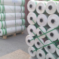 Round roll bale wrapping net for baler