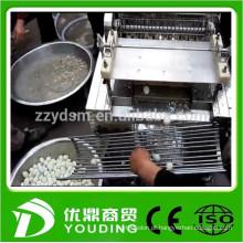 máquina automática de descasque de ovos de codorna e feita de aço inoxidável fácil de limpar