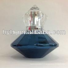 Bouteille de parfum de charme bleu