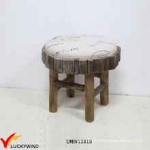 Tabouret rembourré en tissu en bois de petite taille