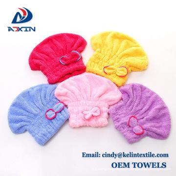 Enveloppe de serviette de cheveux de microfiber avec le chapeau rapide de cheveux mourant de bouton / turban