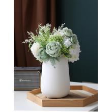 Modern white ceramics small vase