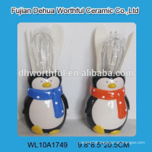 Ceramic utensil holder in penguin shape