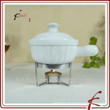 Porcelana mini fondue de chocolate con tenedor