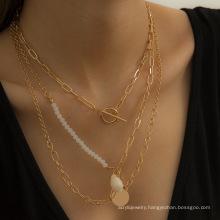 Creative asymmetric shell tassel necklace female retro ot buckle chain multi-layer necklace