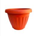 Red round plastic flower pots nursery pots