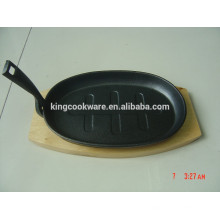 cast iron steak baking sizzling pan with wood base