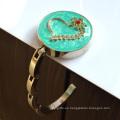 Bolso de la percha de la venta al por mayor Custom Metal Fashion Plegable imán bolsa de mano de la suspensión