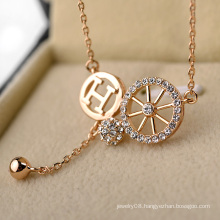 Promotional item artificial gold long chain imitation necklace personalized letter h and wheel crystal necklace