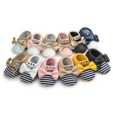 12 Bowknot de colores y borlas y remaches First Walker Baby Shoes Infant Toddler