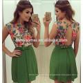Las mujeres sin mangas del color verde del verano del vestido vendedor caliente visten a las mujeres sin espalda atadas florales visten el modelo