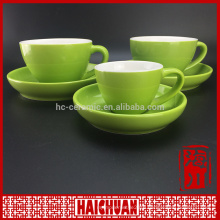 Red cup with wooden saucer