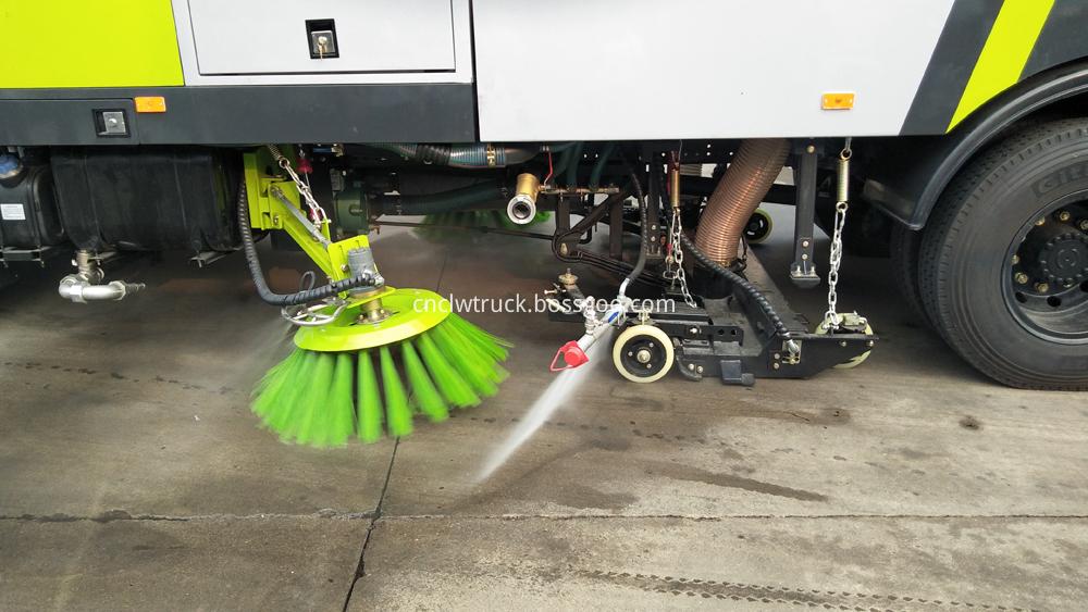 street sweeping truck side spraying