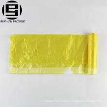 Sac à ordures en plastique à cordon jaune pliable