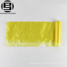 Yellow drawstring plastic garbage bag foldable