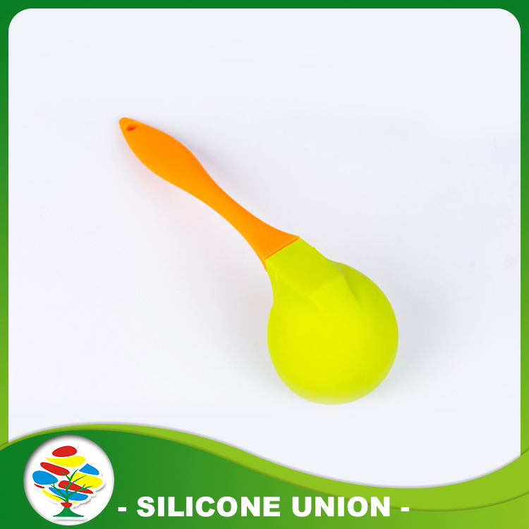 Orange green spoon for cooking